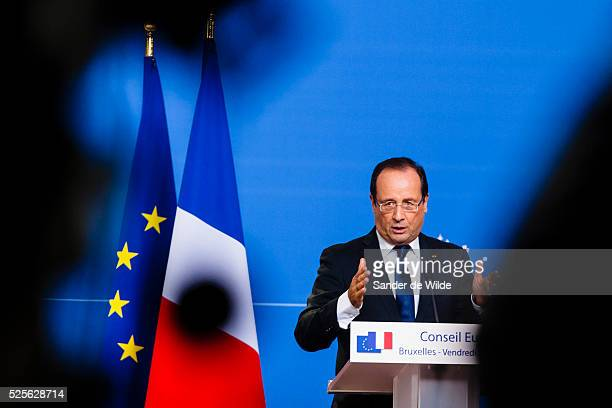 French President Francois Hollande gestures while speaking during a media conference at an EU summit in Brussels on Friday, Oct. 19, 2012. European...
