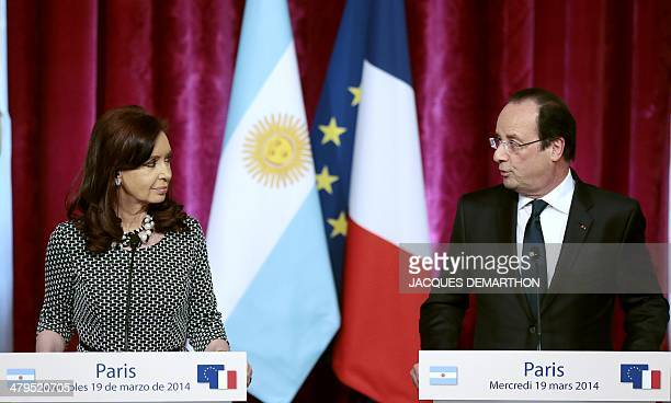French President Francois Hollande gives a joint press conference with Argentinian President Cristina Kirchner at the presidential Elysee Palace in...