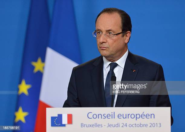 French President Francois Hollande gives a press conference at the end of the first day of the European Union summit on October 25 2013 in Brussels...