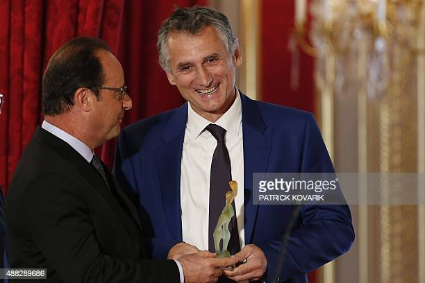 French president Francois Hollande gives CEO of Figeac Aero JeanClaude Maillard the Audacitity creative award at the French Elysee palace on...