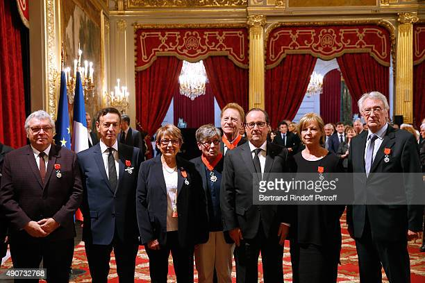 French President Francois Hollande gives to Director of sponsorship LVMH JeanPaul Claverie Insignia of Officer of the Legion of Honor at Elysee...