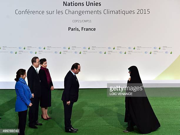 French President Francois Hollande greets Iranian VicePresident Masoumeh Ebtekar as she arrives for the opening of the UN conference on climate...