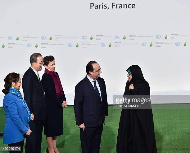 French President Francois Hollande greets Iranian VicePresident Masoumeh Ebtekar upon her arrival for the opening of the UN conference on climate...