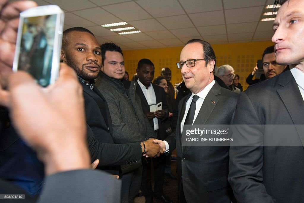 french president francois hollande 2nd r greets residents during the inauguration and visit of