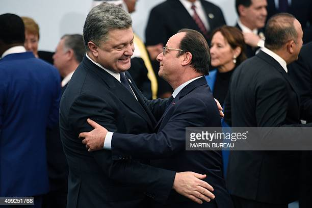 French president Francois Hollande greets Ukraine's President Petro Poroshenko before the family photo during the COP21, United Nations Climate...