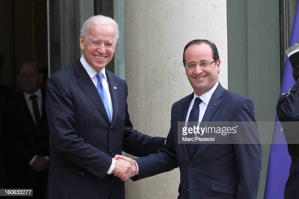 French President Francois Hollande greets Vice President of the United States of America Joe Biden ahead of a meeting at Elysee Palace on February 4,...