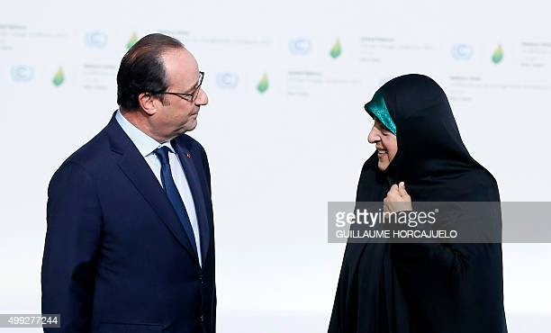 French president Francois Hollande greets Vice President of the Islamic Republic of Iran Masoumeh Ebtekar as she arrives for the COP21 World Climate...