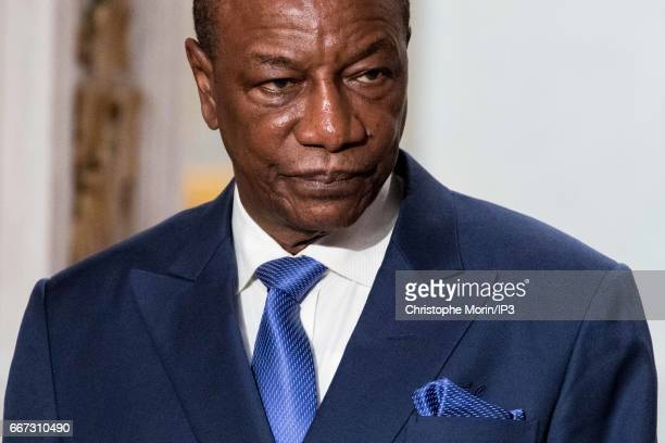 French President Francois Hollande holds a press conference with President of Guinea Alpha Conde after a meeting at the Elysee Palace on April 11...