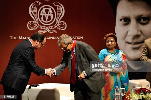 French President Francois Hollande honoring Amartya Sen with Commandeur de la Legion d' Honneur as wife of late Madhavrao Scindia Madhavi Raje...