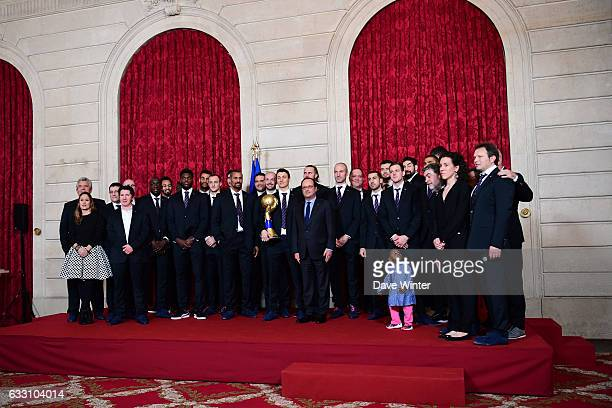 French president Francois Hollande hosts a reception for the France handball team at the Elysee Palace on January 30 2017 in Paris France
