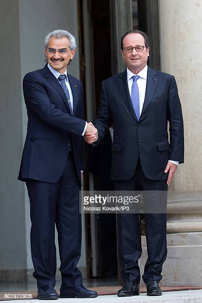 French President Francois Hollande hosts Saudi Prince AlWaleed bin Talal bin Abdulaziz Al Saoud for a meeting at the Elysee Palace on September 8...