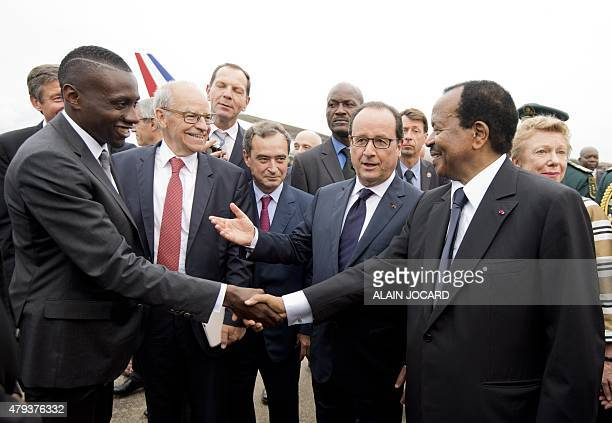 French President Francois Hollande introduces international French football player Blaise Matuidi to his Cameroonian counterpart Paul Biya upon his...