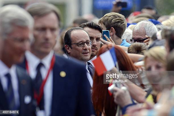 French President Francois Hollande is greeted by a crowd as he arrives at the city hall on August 4 2014 in Liege Belgium to attend commemorations...