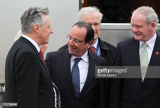 French President Francois Hollande is greeted by Northern Ireland's First Minister Peter Robinson and Deputy First Minsiter Martin McGuinness as he...