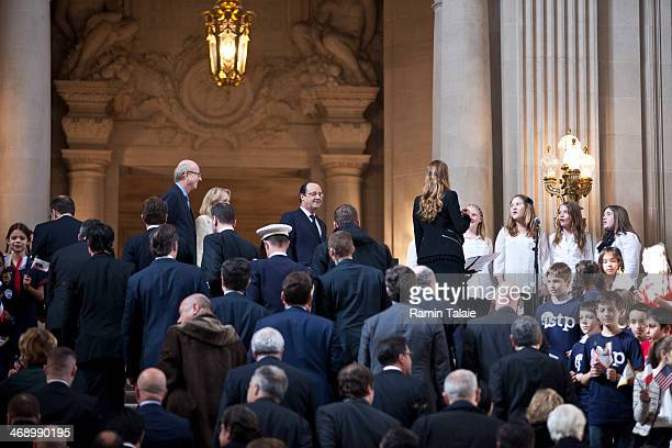 French President Francois Hollande is greeted by school children during a visit to City Hall on February 12 2014 in San Francisco California...