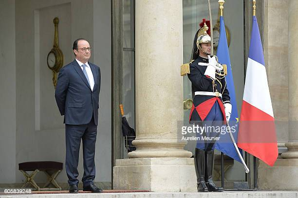 French President Francois Hollande is seen as German Chancellor Angela Merkel leaves the Elysee Palace after a meeting on September 15 2016 in Paris...