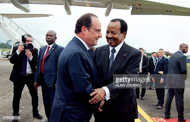French President Francois Hollande is welcomed by his Cameroonian counterpart Paul Biya upon his arrival at the Yaounde Nsimalen international...
