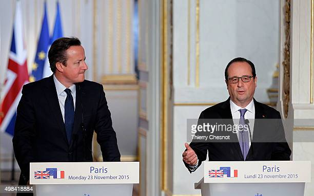 French President Francois Hollande issues a statement during a press conference with British Prime Minister David Cameron at the Elysee Palace on...