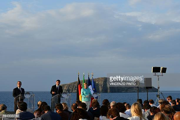 French President Francois Hollande Italian Prime Minister Matteo Renzi and German Chancellor Angela Merkel give a joint press conference aboard of...