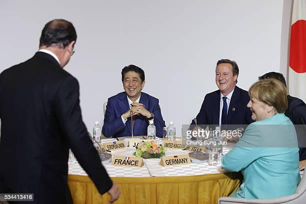 French President Francois Hollande Japanese Prime Minister Shizo Abe British Prime Minister David Cameron and German Chancellor Angela Merkel attend...