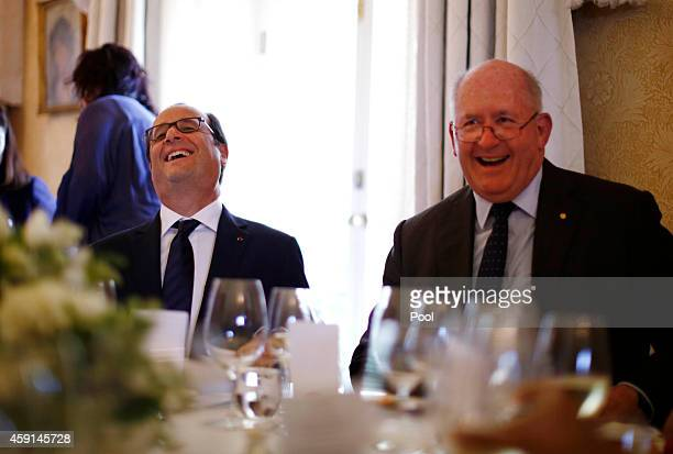 French President Francois Hollande laughs alongside Australia's GovernorGeneral Peter Cosgrove during an official lunch at Admiralty House on...