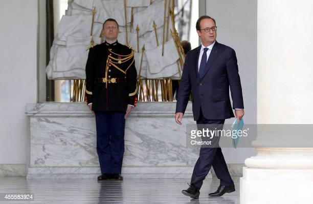 French President Francois Hollande leaves after a weekly cabinet meeting at the Elysee Presidential Palace in Paris on September 17 in Paris France