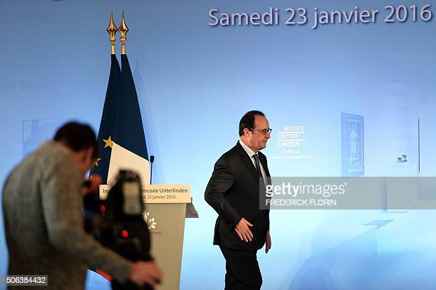 French President Francois Hollande leaves after delivering a speech during the inauguration of the Unterlinden museum of Colmar eastern France on...