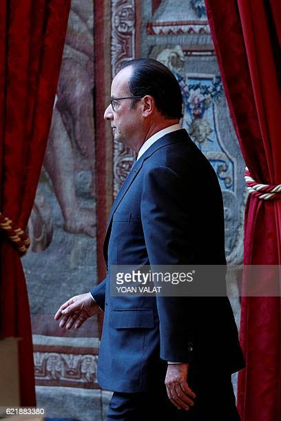French President Francois Hollande leaves after making a statement at the Elysee Palace in Paris on November 9 following the results of US...
