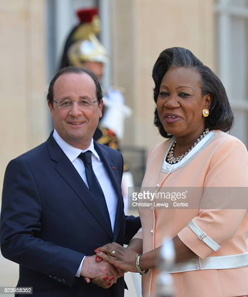 French President Francois Hollande, left, welcomes interim Central African Republic President Catherine Samba-Panza, as they pose for photographers...