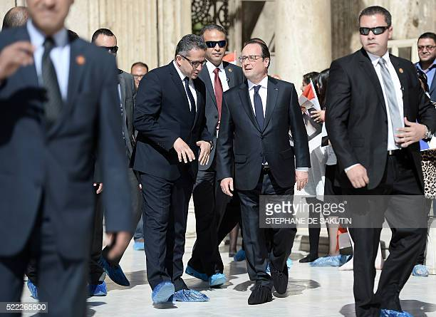 French President Francois Hollande listens to Egypt's Antiquities Minister Khaled alAnani during a visit at the Mohamed Ali Mosque at the Citadelle...