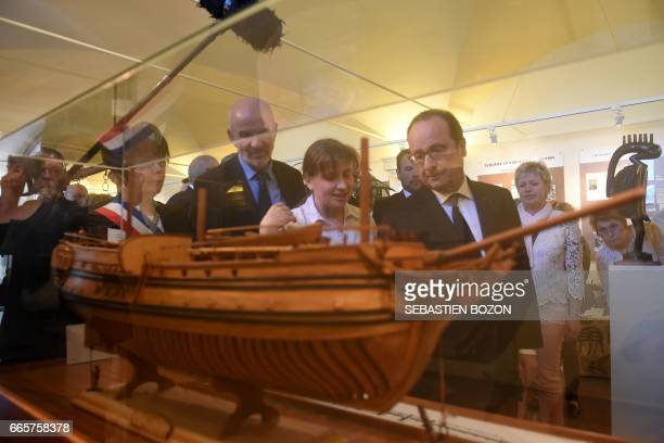 French President Francois Hollande looks at a galley as he visits the Negritude house on April 7 2017 in Champagney eastern France / AFP PHOTO /...