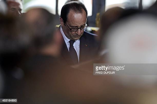 French President Francois Hollande looks down on August 4 2014 at the city hall in Liege Belgium during commemorations marking 100 years since the...
