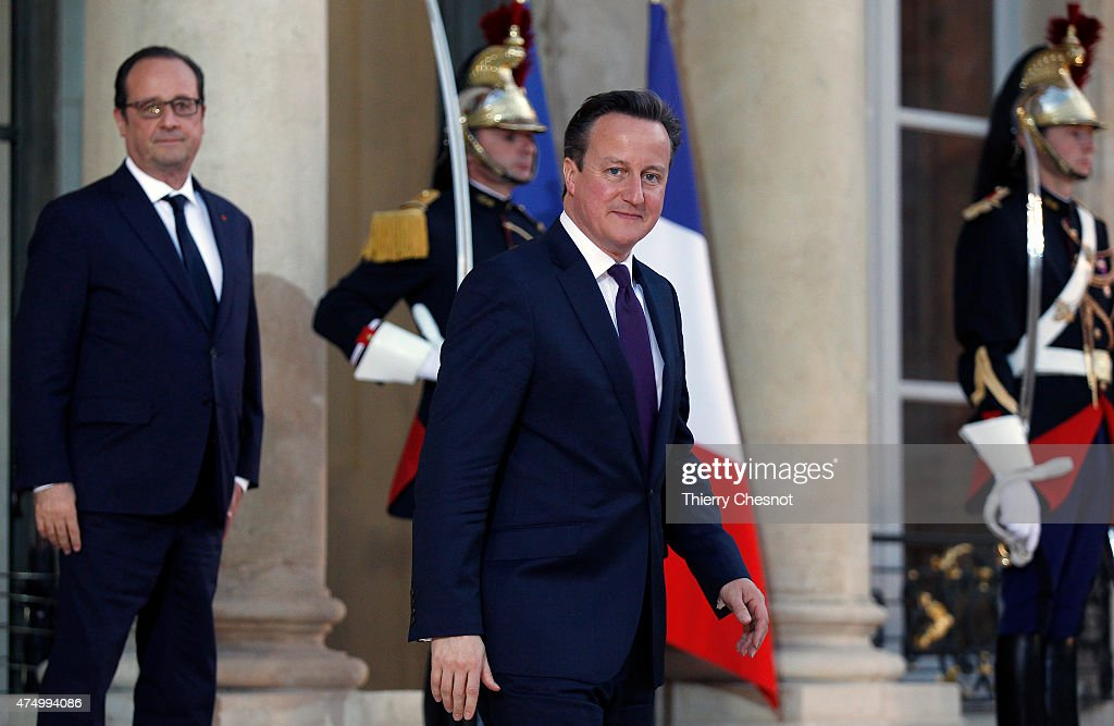 French President Francois Hollande looks on as British Prime Minister David Cameron leaves after their meeting at the Elysee Palace on May 28, 2015 in Paris, France. David Cameron met Francois Hollande to discuss the situation concerning the United Kingdom in the European Union.