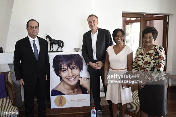 French president Francois Hollande meets members of Zakakely Sambatra association, an association for youth education, on November 27, 2016 in...