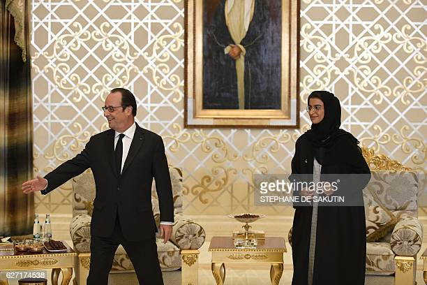 French President Francois Hollande meets with Emirati State Minister to the United Arab Emirates' Federal National Council Noura alKaabi upon his...