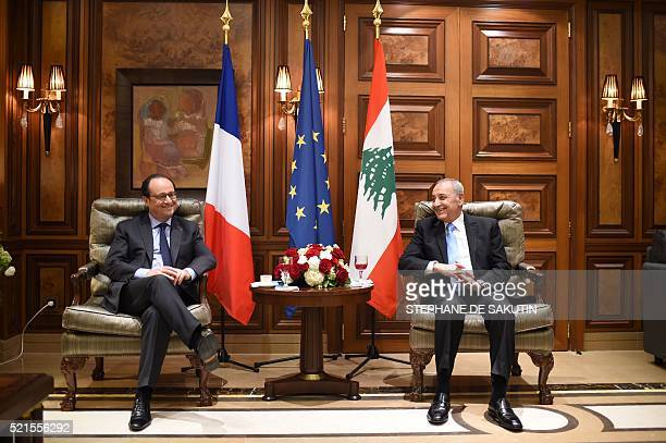 French President Francois Hollande meets with Lebanese parliament speaker Nabih Berri following his arrival in Beirut on April 16 2016 Hollande...