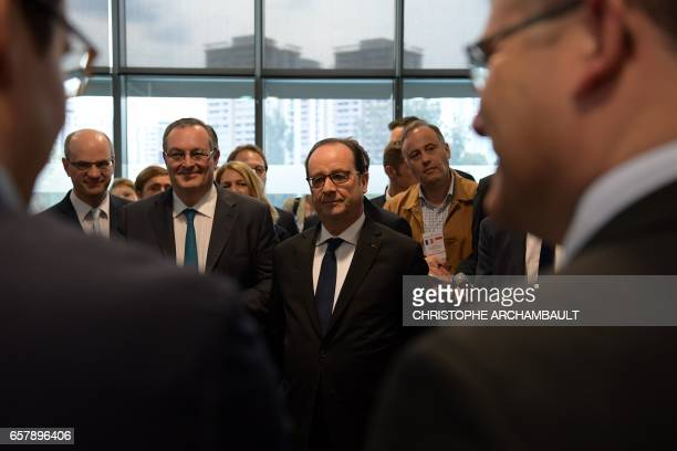French President Francois Hollande meets with members of the French tech hub at the ESSEC AsiaPacific business school during his visit to Singapore...