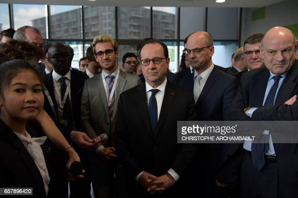 French President Francois Hollande meets with students at the ESSEC AsiaPacific business school during his visit to Singapore on March 26 2017...
