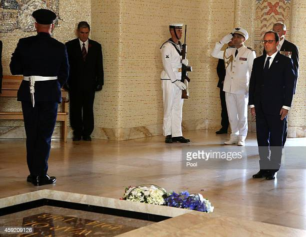 French President Francois Hollande pauses after laying a wreath at the Australian War Memorial on November 19 2014 in Canberra Australia French...