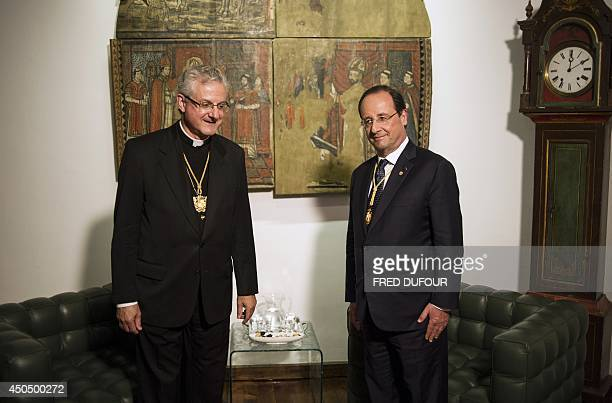 French President Francois Hollande poses for a photograph alongside Andorra coPrince Urgel Archbishop Joan Enric Vives Sicilia during a meeting at...