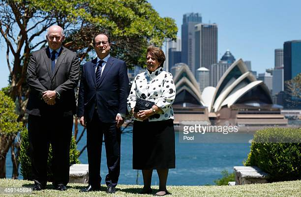 French President Francois Hollande poses with Australia's Governor-General Peter Cosgrove and his wife Lynne Cosgrove in front of the Sydney Opera...