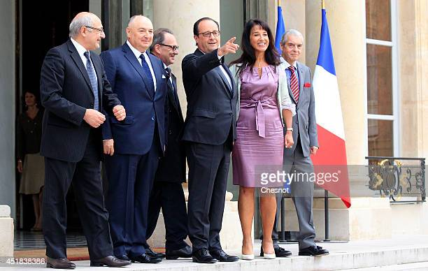 French President Francois Hollande poses with Chairman of the European Jewish Congress Moshe Kantor and a delegation after their meeting at the...