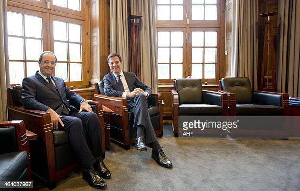 French President Francois Hollande poses with Dutch Prime Minister Mark Rutte at the Parliament building in The Hague, The Netherlands, on January...