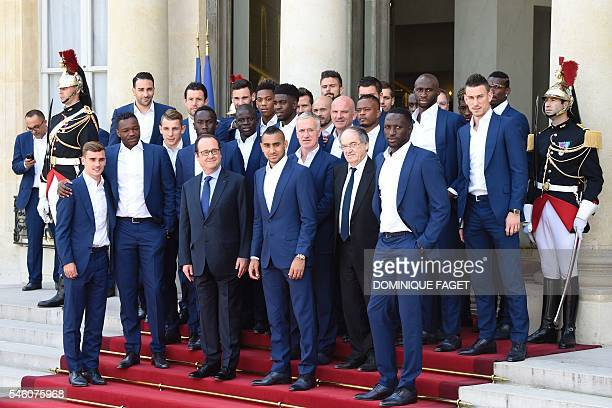 French President Francois Hollande poses with France's coach Didier Deschamps French Football Federation president Noel Le Graet and France's...