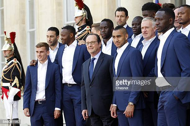French President Francois Hollande poses with France's forward Antoine Griezmann goalkeeper Steve Mandanda France's forward Dimitri Payet France's...