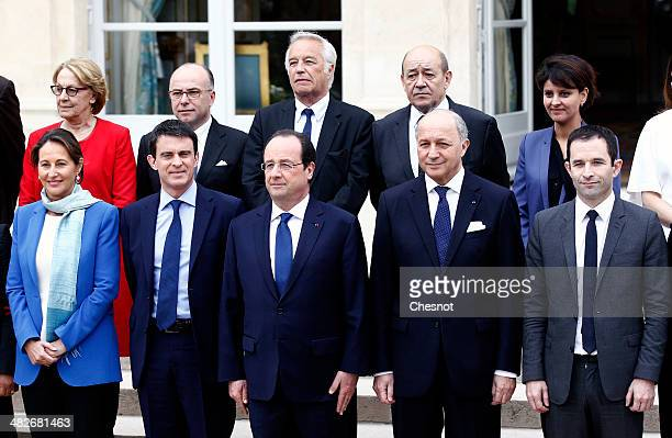 French President Francois Hollande poses with France's newly appointed Prime Minister Manuel Valls and members of the government State Reform and...