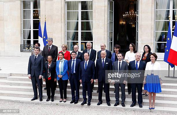 French President Francois Hollande poses with France's newly appointed Prime Minister Manuel Valls and members of the government Overseas Territories...