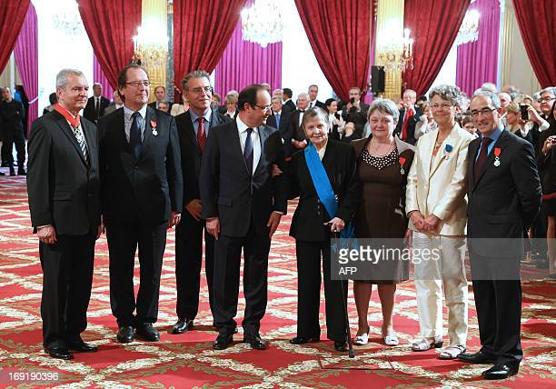 French president Francois Hollande poses with general honorary prosecutor Henri Desclaux lawyer Christian CharriereBournazel chairman of the regional...