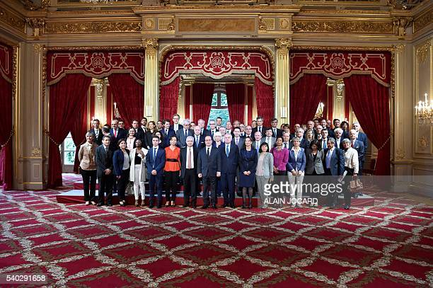 French President Francois Hollande poses with President of the French National Assembly Claude Bartolone French Foreign Minister JeanMarc Ayrault...