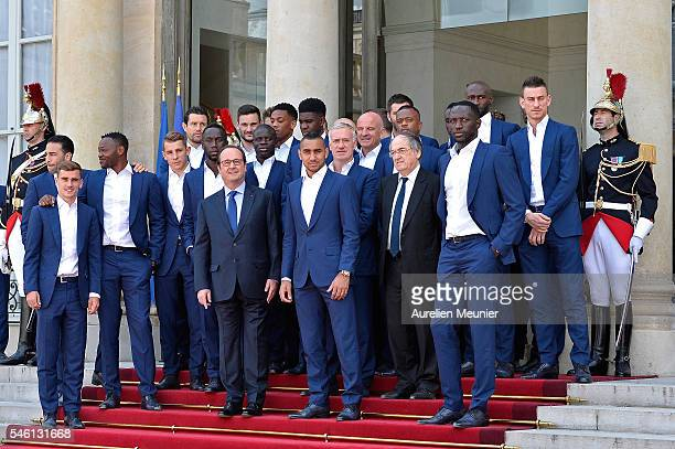 French President Francois Hollande poses with the soccer France national team as they arrive at Elysee Palace for a lunch in their honor on July 11...